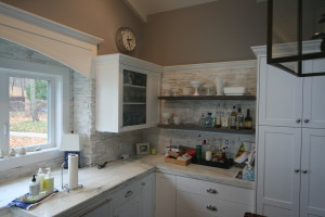 Glass fronted cabinets with reclaimed shelves